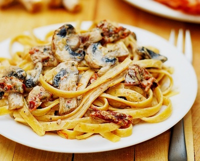 Tomato and mushroom pasta in a garlic and basil sauce picture